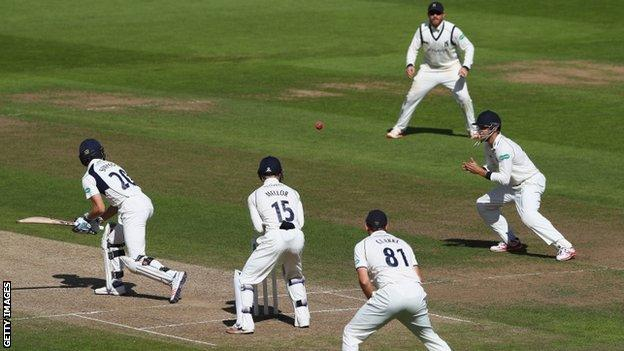 Middlesex wicketkeeper John Simpson was the second of Josh Poysden's five victims, caught at short leg by Sam Hain