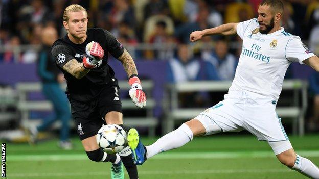 Loris Karius' throw is blocked by Karim Benzema for a Real Madrid goal
