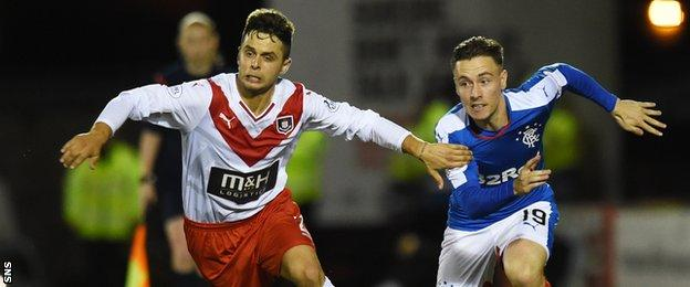 Airdrieonians' Jamie Bain tussles with Barrie McKay