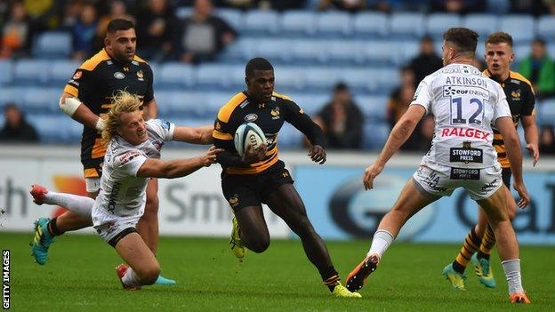 Christian Wade runs between a gap in the Gloucester defence while playing for former club Wasps