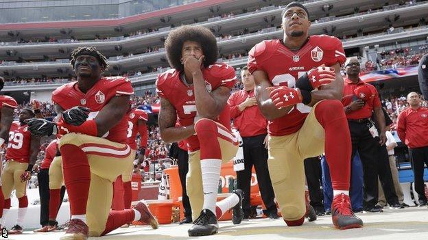Colin Kaepernick (centre) is the quarterback to lift the 49ers out of their slump