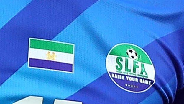 The Sierra Leone Football Association logo and Sierra Leone flag