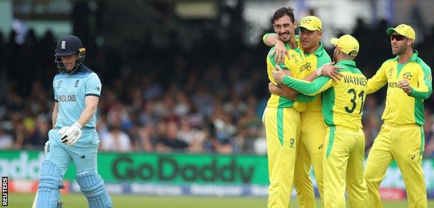 Eoin Morgan walks off after being dismissed by Mitchell Starc at Lord's