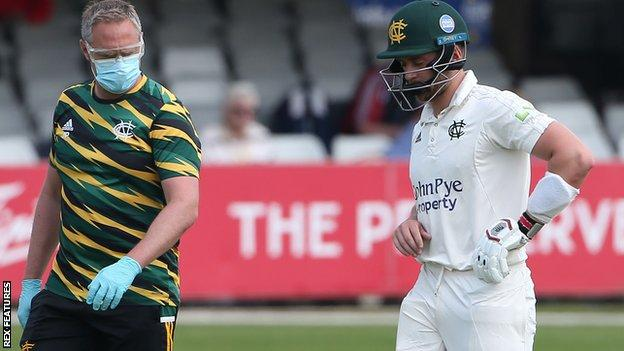 Joe Clarke retires hurt after being struck on his right hand by Sam Cook