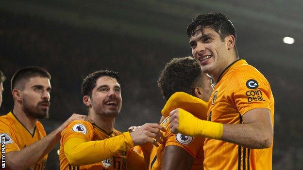 Raul Jimenez (right) celebrates with Wolevs team-mates