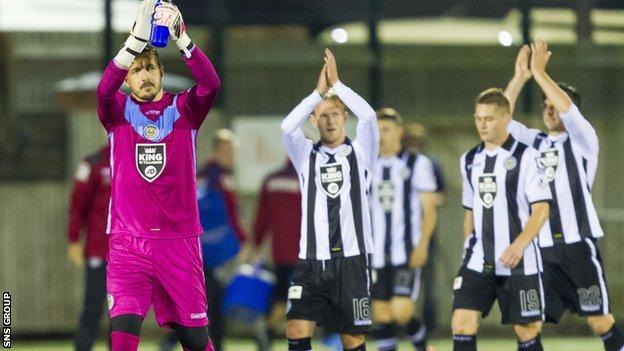 St Mirren players applaud their fans at Galabank