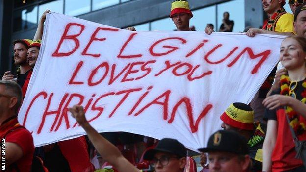 Belgium fans with an Eriksen banner