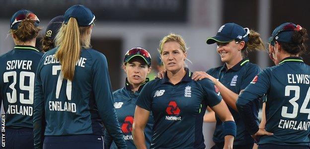 Katherine Brunt celebrates a wicket with teammates
