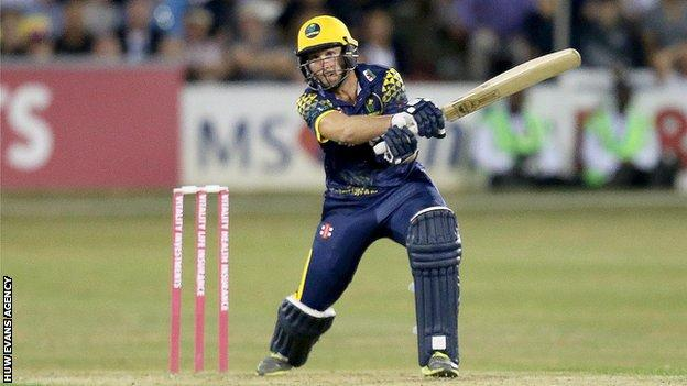 Chris Cooke of Glamorgan hits a huge 6 on the way to victory