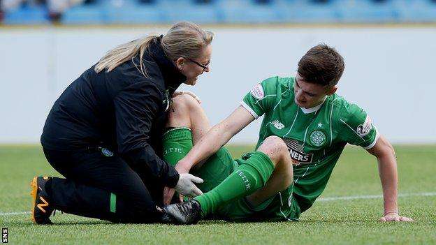 Celtic defender Kieran Tierney receives treatment on an ankle injury