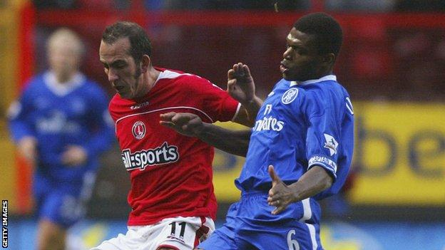 Marcel Desailly tackles Paulo Di Canio