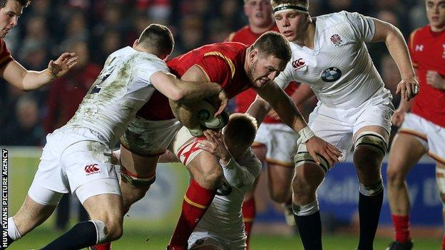 Harrison Keddie of Wales is tackled by George Worth and Mathew Protheroe