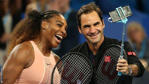 Serena Williams and Roger Federer smile as they pose together for a selfie taken by Federer