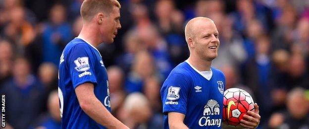 Steven Naismith walks off with the match ball after his hat-trick against Chelsea at Goodison