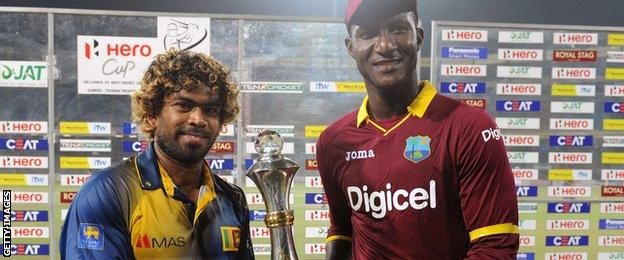 Captains Lasith Malinga and Jason Holder with the T20 series trophy
