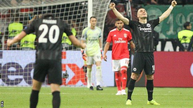 Eintracht Frankfurt players celebrate beating Benfica in the Europa League