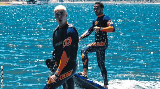 Lewis Hamilton and Justin Bieber surfing