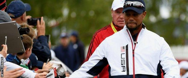Vice-captain Tiger Woods of the United States high fives fans during practice prior to the 2016 Ryder Cup