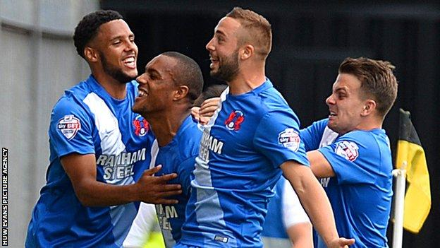 Jay Simpson celebrates scoring with his Leyton Orient team-mates