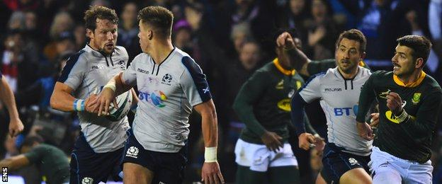 Scotland's Huw Jones offloads to Peter Horne against South Africa