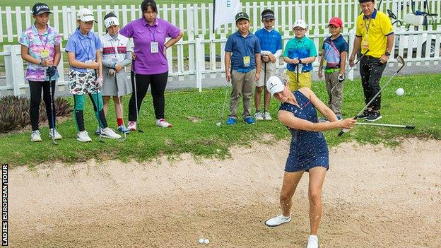 Annabel Dimmock playing out of a bunker