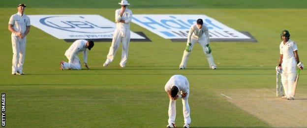 Ian Bell reacts after dropping Asad Shafiq
