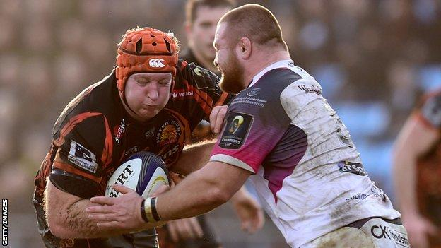 Thomas Waldrom (left) makes a break for Exeter against Ospreys