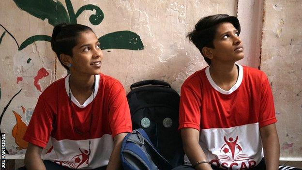 Saini (left) and Prajapati (right) in their football kits