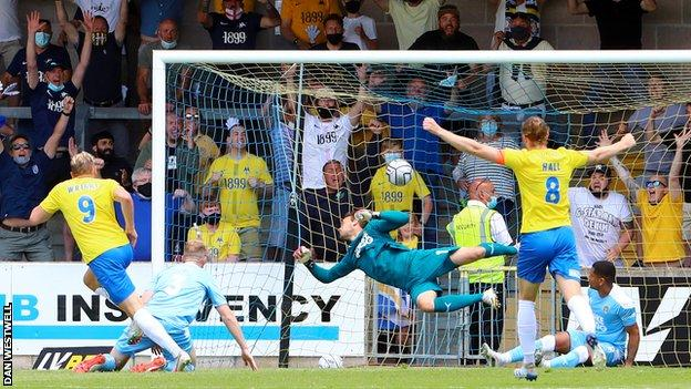 Danny Wright scores his second goal for Torquay