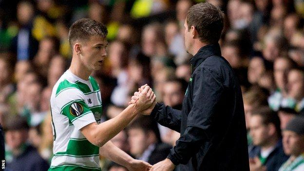 Celtic's Kieran Tierney is congratulated by manager Ronny Deila