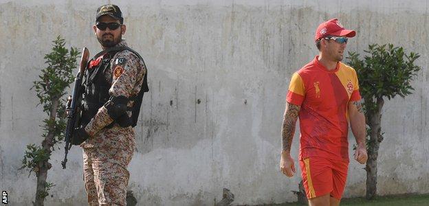 New Zealand's Luke Ronchi trains under armed guard in Karachi