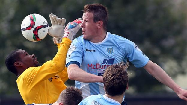 Ballinamallard keeper Alvin Rouse clashes with Ballymena United's Allan Jenkins at the Showgrounds, where both teams had a player dismissed