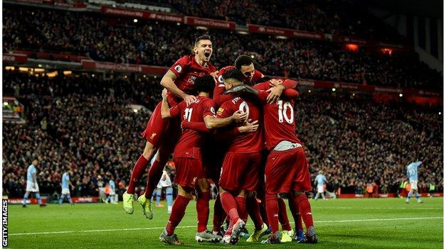 Liverpool celebrate against Manchester City