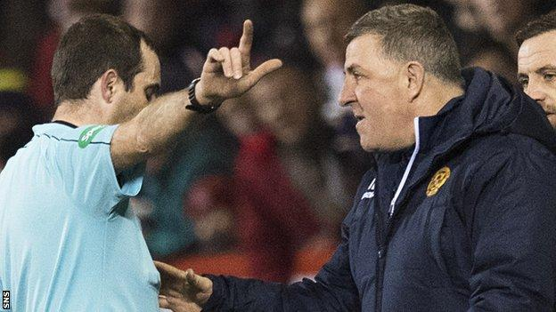 Referee Alan Muir sends Motherwell manager Mark McGhee to the stand at Pittodrie