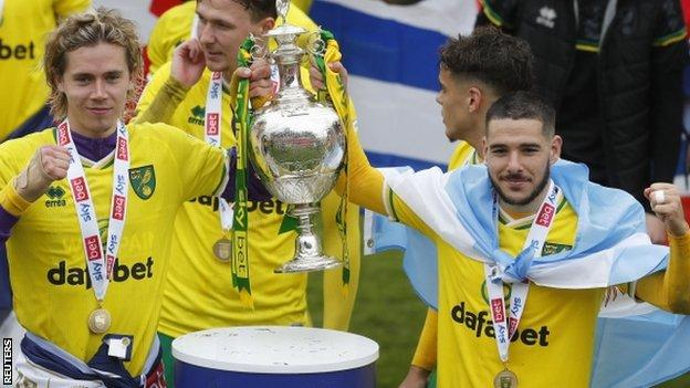 Norwich players Todd Cantwell and Emiliano Buendia with the Championship trophy