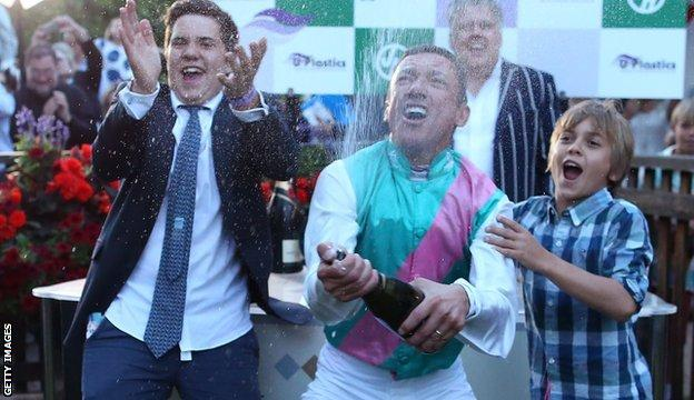 Frankie Dettori celebrates with his sons Leo (L) and Rocco after riding his 3000th