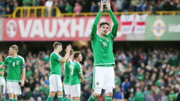 Northern Ireland striker Kyle Lafferty applauds the home support at Windsor Park