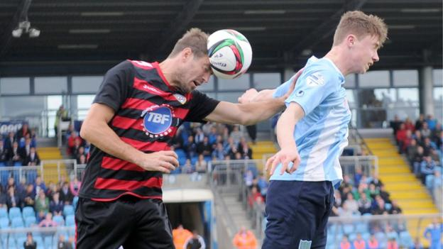 Steven Douglas and Matthew Shevlin in action as Coleraine defeat derby rivals Ballymena United 2-0 at the Showgrounds