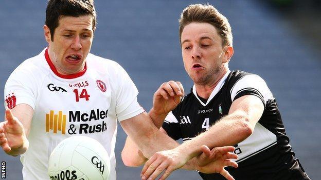 Tyrone's Sean Cavanagh battles with Sligo's Daniel Maye at Croke Park