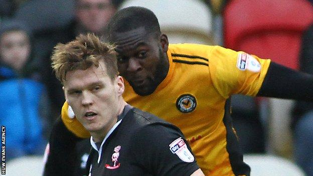 Frank Nouble of Newport County competes with Lincoln's Sean Raggett