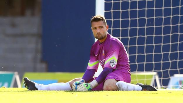 Glenavon goalkeeper Jonathan Tuffey looks dejected after conceding a goal in his side's 4-3 defeat by Glenavon at Windsor Park