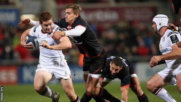 Paddy Jackson makes a break for Ulster as Toby Flood attempts to halt his progress at Kingspan Stadium