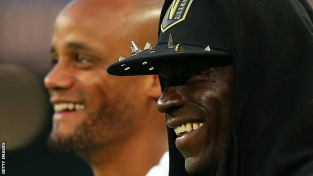 Kompany's former City teammate Mario Balotelli (right) was at the match but did not play