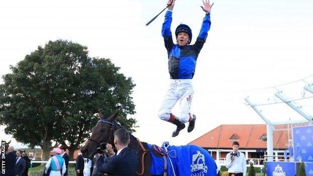 Frankie Dettori celebrates after winning at Newmarket