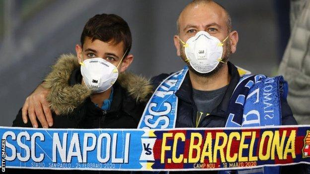 Fans at the Napoli v Barcelona Champions League game wearing face masks