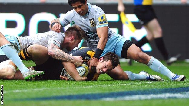 Wasps' Rob Miller is held up by Northampton's defence just before the line