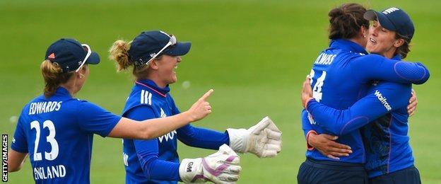 England celebrate a catch by Jenny Gunn (far right)