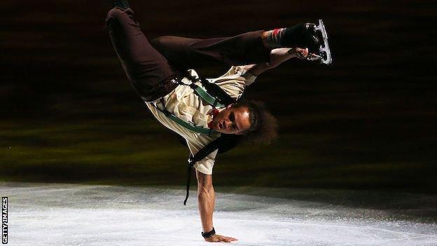 Elladj Balde performing at the 2014 World Figure Skating Championships