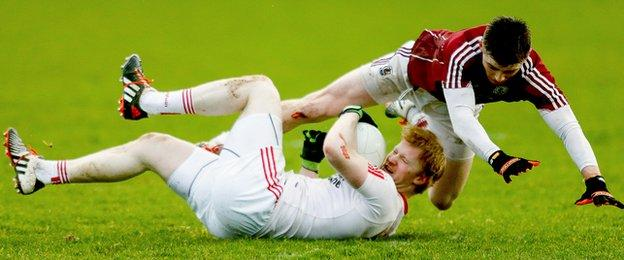 Tyrone substitute Hugh Pat McGeary and Galway's Daithi Gaoithin take a tumble during the Division Two clash