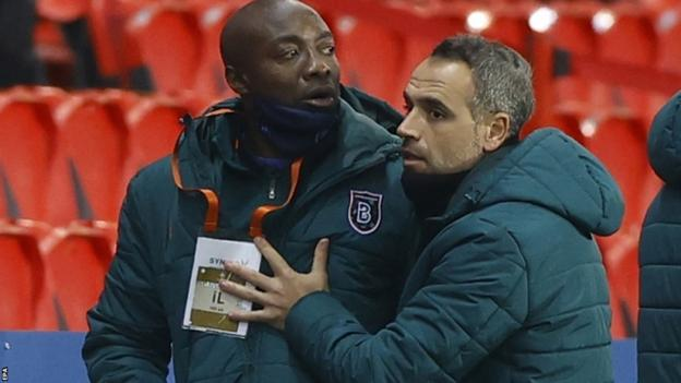 Pierre Achille Webo (L), assistant coach of Basaksehir, reacts during a Uefa Champions League game between Paris St-Germain and Istanbul Basaksehir.